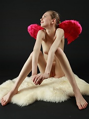 Skinny small titted naked angel with pink wings