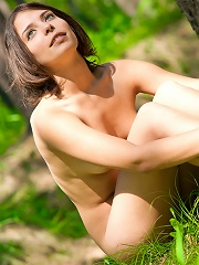 Hot girl takes off her dress while walking in the woods and shows off her tits and pussy.