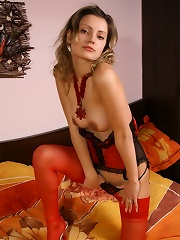 Teen in red corset and stockings strips