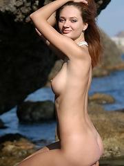 Zemani.com Ella - Naked beautiful young busty girl poses on the sea rocks.
