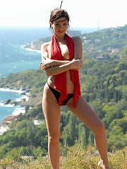 Zemani.com Karina - Charming busty girl removes her red swimsuit and poses on a wonderful seaside landscape.