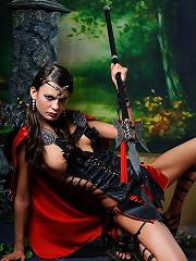 Brunette Salma the sexy gladiator rubs herself